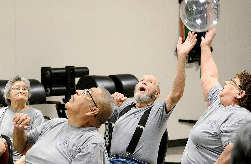 KEVIN HARVISON | Staff photo Members of Team Wilburton return a ball during a chair volleyball tournament at the Crowder Choctaw Nation of Oklahoma Wellness Center.