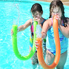 "KEVIN HARVISON | Staff photo<br /> Pictured from left, Hope Wilbur and Ambree Parker play the ""water horns"" while spending some time at the Chadick Park wadding pool."