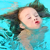 KEVIN HARVISON | Staff photo<br /> Wylie Long creates a kaleidoscope effect as he keeps his head above water while swimming at Jeff Lee Pool.