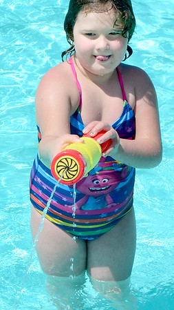 KEVIN HARVISON | Staff photo<br /> Isabell Wilbur shoots some friends with a water gun while playing at the Chadick Park Wadding Pool.