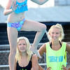 KEVIN HARVISON | Staff photo<br /> Lifeguards watch as Tenley Waller dances to the end of the diving board at Jeff Lee Pool celebrating the end of swim lessons.