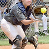 KEVIN HARVISON | Staff photo<br /> Hartshorne catcher takes a throw to the plate as a McAlester runner scores duirng an exhibition Friday at the McAlester High School Softball Field.