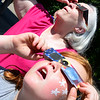 Kevin Harvison | Staff photo<br /> Sonja Williams, left and Shaylee Barnes look up at the solar eclipse Monday during the Pittsburg County Library Solar Eclipse watch party.