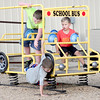 Kevin Harvison | Staff photo<br /> At right, Gunner Luker, reacts as Case Chapman falls out of the playground school bus while the boys were recently playing on the Stuart playground.