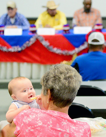 Kevin Harvison | Staff photo<br /> Future voter Braleigh Denise Spears is held by Margaret Lemons during the McAlester News Capital political forum Tuesday night at the EOSC conference room in McAlester.