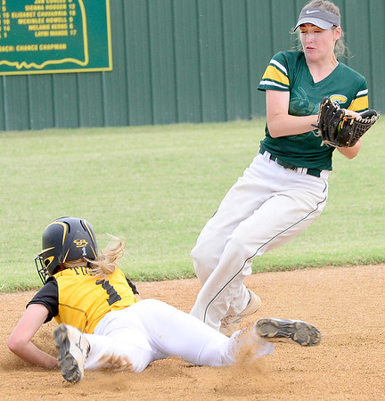 Kevin Harvison | Staff photo<br /> Stuart varsity second baseman Elizabeth Brewer doubles up a Moss baserunner during a recent home game.