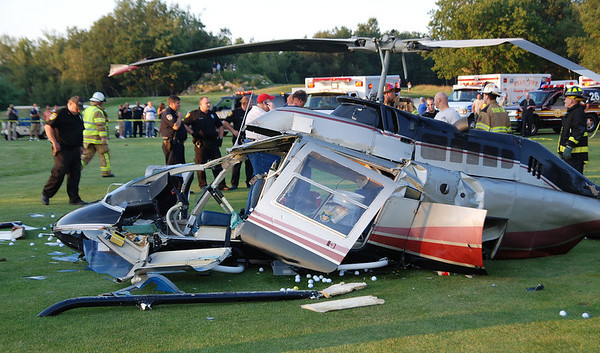 The remains of a helicopter that crashed at Mountain Valley Golf Course Friday evening.