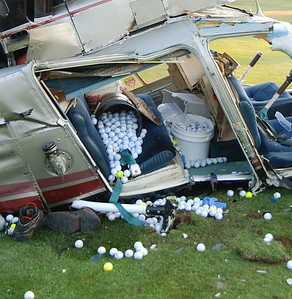 Golf balls aboard the hekicopter that were scheduled to be dropped off at Mountain Valley Golf Course,