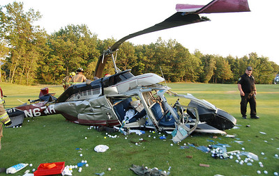 The remains of a private helicopter that crashed at Mountain Valley Golf Course Friday evening.