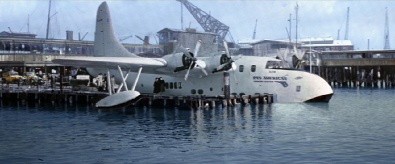 The shot was achieved by putting a scaffolding jetty alongside the plane, painting in the surrounding buildings and filming water separately. Once all together the shot worked beautifully. We may well be able to achieve something like this.
