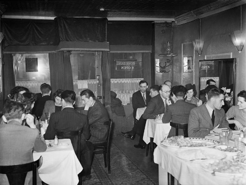 Customers enjoy a meal in the very busy Istanbul restaurant at number 12 Frith Street, Soho, London, 1943.