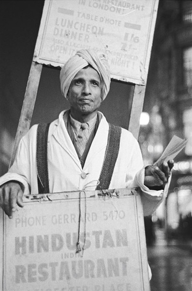 Sandwich board man advertising Shafi Hindustan Restaurant, 18 Gerrard Street, London by E.O. Hoppé, 1945