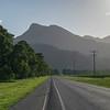 Road passing through field, Far North Queensland, Queensland, Australia