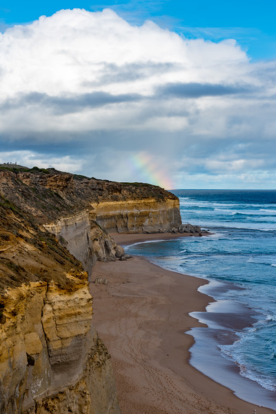 Rainbow behind the cliffs