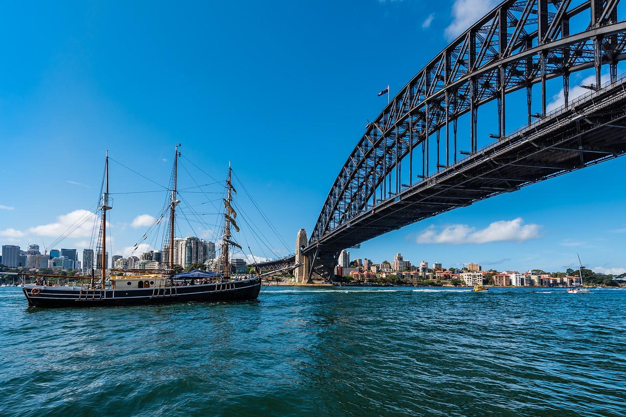 Sailing Boat cruising under the Sydney Harbor Bridge