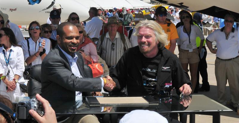 Sir Richard Branson and Sheikh Mansour bin Zayed al-Nahyan from Abu Dhabi, sealing the 280 million dollar deal.