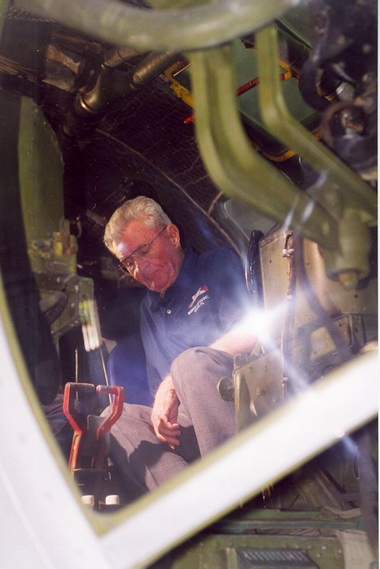 Gen. Paul Tibbets reminiscing in the cockpit of the B29 Fertile Myrtle at the Weeks Air Museum. Michael Jones Photograph.