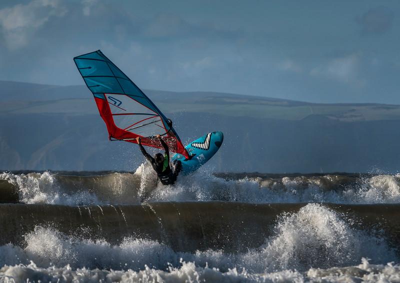 Windsurfing barrel waves.