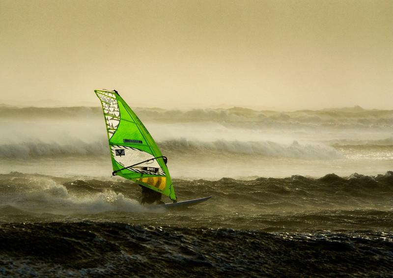 Windsurfing at twilight.