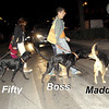 """Maddie off leash, helping the younger dogs cross the busy street. Sade, Fifty, Boss, Neus. In this pic, only Fifty is also off leash.  Maddie """"raised"""" Fifty and Sade ."""