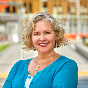 Business headshot with JUMP in background