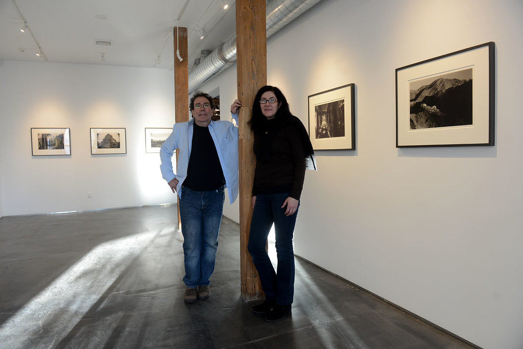. Tania Barricklo-Daily Freeman  Aaron Rezny, left, owner of 76 Prince Street Studios in Midtown Kingston, N.Y. and Hannah Frieser, executive director of Center of Photography at Woodstock (CPW) stand in the gallery space where they are featuring a show by renowned photographer Kenro Izu titled Sacred Places through January. The opening is a fundraiser for the CPW on December 16 from 3-6 pm.