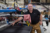 David LaChance — Bennington Banner<br /> Scott Elithorpe, president of Abacus Automation, explains how a machine packs curtain rods into plastic sleeves. The machine can produce two packages every three seconds.