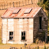 Tall barn in a field