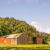 Red barn with collapsing wall in Waimoto North-