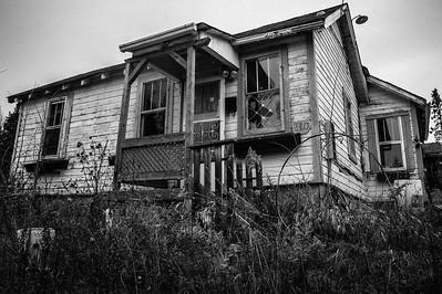 Window watcher, abandoned house near Pass Lake Ontario
