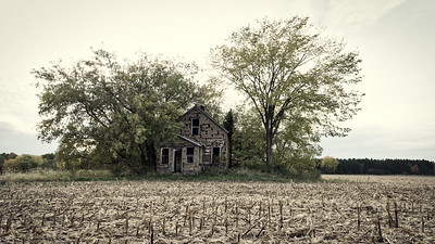Surrounded by cornfields, this house is left to supervise with empty eyes. Found on County Road E, but I forget which county.