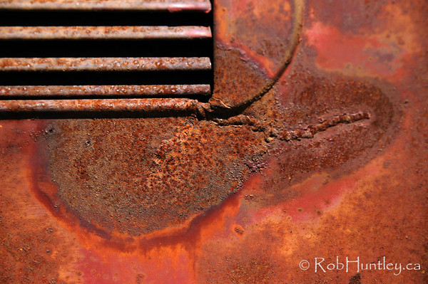 Detail of a vintage car abandoned by the roadside in southern British Columbia.
