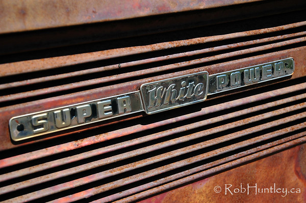 Detail of a vintage car abandoned by the roadside.