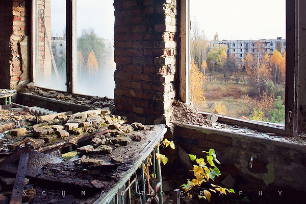 View out the window of a classroom in the school. This building is in particularly bad shape and is partially collapsed.