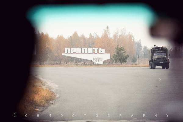 Sniper shot of the Pripyat sign and a military passerby. A common sight that is both unsettling and appropriate.