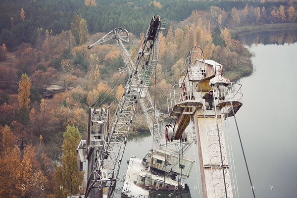 The size of these cranes completely dwarfs the size of my companions.  You can see the 4th crane at the end of the line has fallen into the river. A fact that I had not noticed until I had climbed up here.