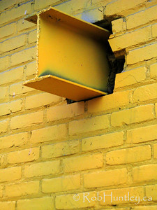 Protruding beam. Yellow beam poking through the exterior wall of a derelict yellow painted house.  License this photo on Getty Images  © Rob Huntley