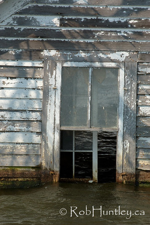 Water above the windows. Derelict and swamped farmhouse on Hwy 46, east of Gackle, North Dakota.  This photo is a similar to an image Licensed through Getty Images. If you are interested in this specific image, please contact me to arrange for licensing through Getty Images.  © Rob Huntley