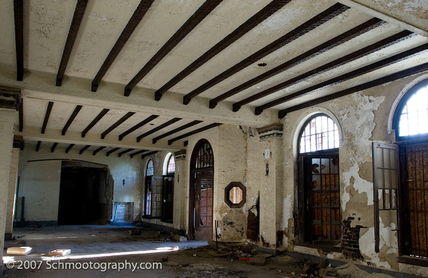 Grand foyer of an abandoned apartment building. The architecture of this structure was once very lovely in an old-world style.