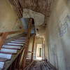 Looking up the stairs to the 3rd floor and down the hall to one of the back bedrooms.