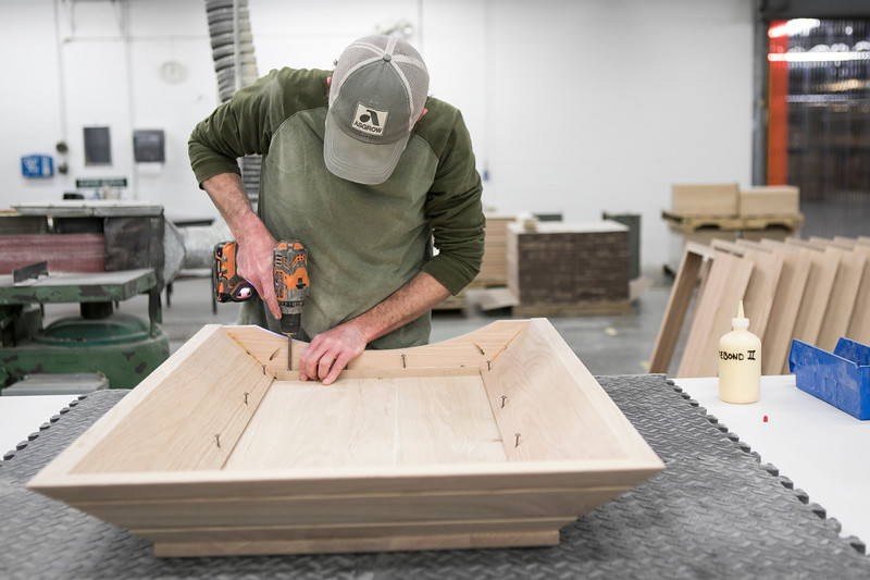 On Tuesday, March 20, Ross assembled casket lids while Ross stained the lids.