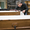 Abbey Caskets co-workers Eric Boeglin and Ross Tempel finished caskets in the workshop at Saint Meinrad Archabbey on Tuesday, Dec. 4, 2018.