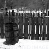 Water barrel, fence, & snowy lane at Lincoln Log Cabin State Park near Charleston, IL
