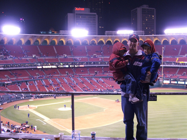 Dad and boys at game