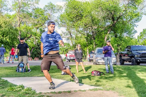 disc golfer throws disc
