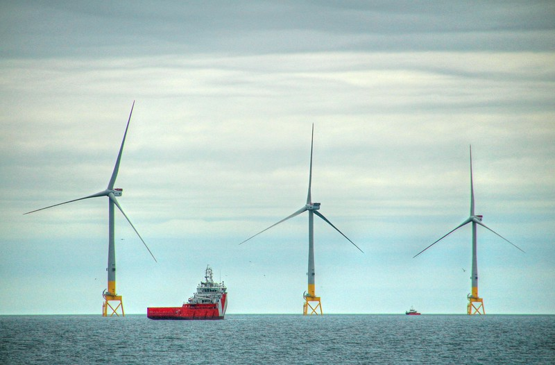 Wind Turbines and Support Vessel in the Bay