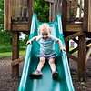 Julia Scutella, 1, enjoys the slide at Timothy's Playground on June 13, 2018.ABIGAIL DOLLINS/STAFF PHOTOGRAPHER