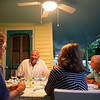 Former Chautauqua Institution President Tom Becker enjoys dinner and conversation on his friends' Sid and Anita Holec's front porch on June 14, 2018. ABIGAIL DOLLINS/STAFF PHOTOGRAPHER