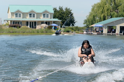 Lourdes Mack, 16, of Santa Monica smiles as she water skiis Tuesday. Kids who rely on wheelchairs get an opportunity to water ski along side of former champions as coaches during the Ability First week-long camp in Chico, Calif. Tues. June 19, 2018.   (Bill Husa -- Enterprise-Record)