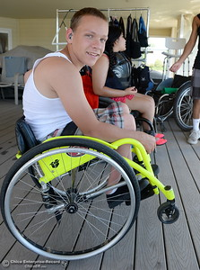 14-year-old Nicholas McGee balances his chair in a wheelie position as he waits for his turn to water ski Tuesday.  Kids who rely on wheelchairs get an opportunity to water ski with help from former champions as coaches during the Ability First week-long camp in Chico, Calif. Tues. June 19, 2018.   (Bill Husa -- Enterprise-Record)